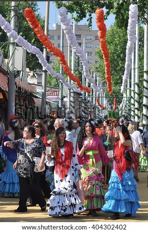SEVILLE, SPAIN-MAY 4: Women dressed in flamenco in Seville Fair. on May 4, 2011 in Seville - stock photo