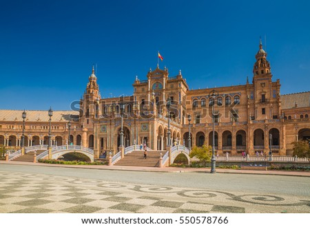 SEVILLE, SPAIN - OCTOBER, 2016: Beautiful Spain Square (Plaza de Espana) built on 1928 -  example of the Regionalism Architecture mixing Renaissance and Moorish styles.