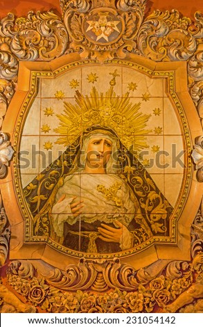 SEVILLE, SPAIN - OCTOBER 29, 2014: The ceramic tiled, cried Madonna on the facade of church Iglesia San Bonaventura by Enrique Orce Marmol (1951).