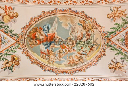 SEVILLE, SPAIN - OCTOBER 28, 2014: The fresco of angels with the symbolic crown on the ceiling in church Hospital de los Venerables Sacerdotes  by Juan de Valdes Leal (1622 - 1690). - stock photo