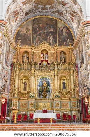 SEVILLE, SPAIN - OCTOBER 29, 2014: The main altar of baroque church Basilica del Maria Auxiliadora.  - stock photo