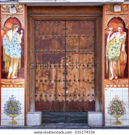SEVILLE, SPAIN - October 10: Traditional ceramic Azulejos decorating a door in Triana district, on October 10, 2015 in Seville, Spain