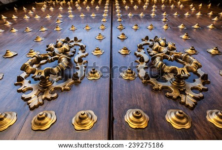 Seville, Spain. Old door detail, made of wood, 200 years old. - stock photo