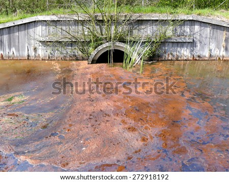 Sewage drainage system with polluted water - stock photo