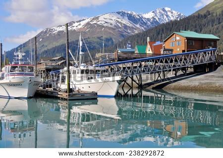 SEWARD, ALASKA - JUNE 5: Harbor of Seward village in Alaska on June 5, 2011. Seward's Boat Harbor is situated on the northern edge of Resurrection Bay. - stock photo