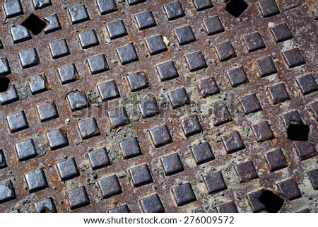 Sewer Cover Close Up - stock photo