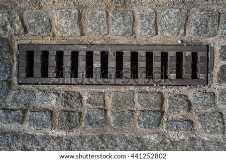 Sewer grate - drainage for heavy rain - stock photo