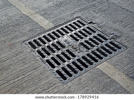 sewer manhole cover in a city street  - stock photo