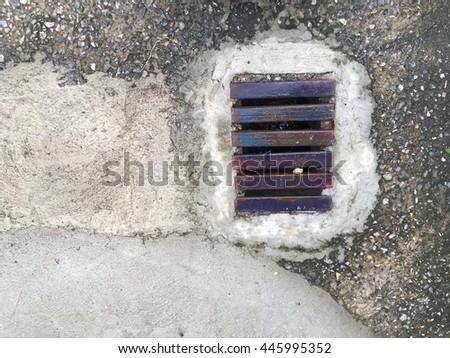 Sewer manhole on the urban asphalt road. - stock photo
