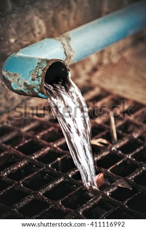 sewer pipe and the grille - stock photo