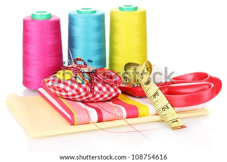Sewing accessories and fabric isolated on white - stock photo