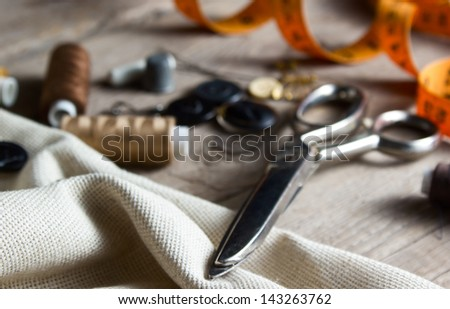 Sewing accessories on wooden table - stock photo