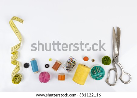 sewing accessories with copy space on white - stock photo