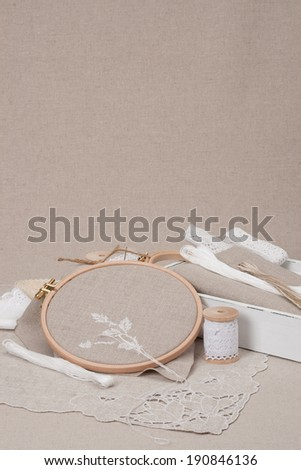 Sewing And Embroidery Craft Kit. Natural Linen Background - stock photo