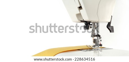 Sewing background. Sewing machine and fabric on a white background. - stock photo
