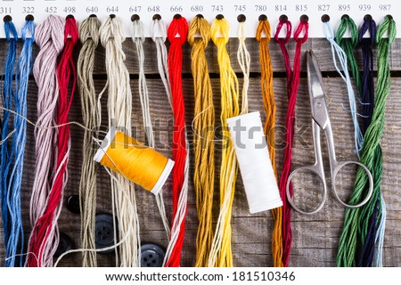 Sewing background with color threads - stock photo