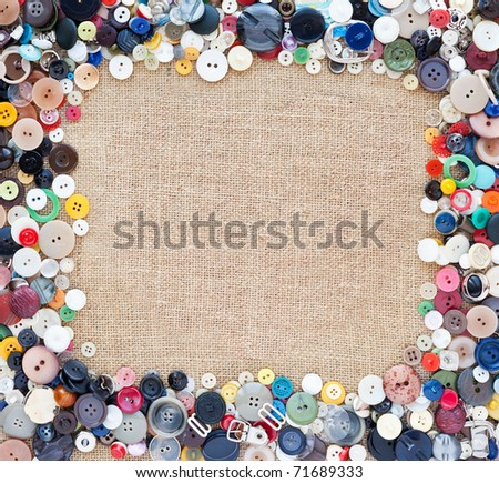 sewing buttons frame on fabric texture background - stock photo