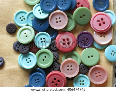 Sewing buttons, Plastic buttons, Colorful buttons on white background, Buttons close up . - stock photo
