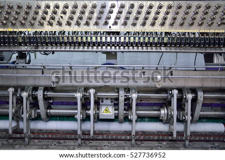 sewing equipment, loom. Equipment at a garment factory.