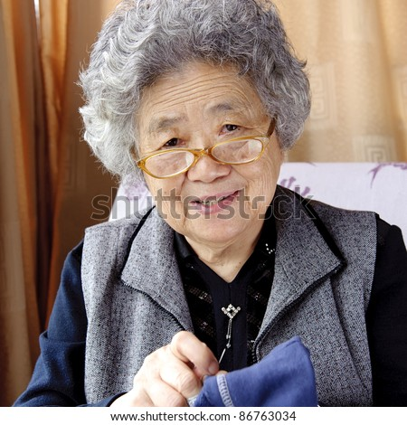 sewing grandmother - stock photo