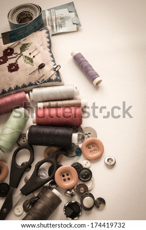 Sewing kit. Scissors, bobbins with thread, needles and button for clothes - stock photo