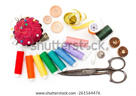 Sewing kit: scissors, measuring tape, thimbles, threads and buttons - stock photo