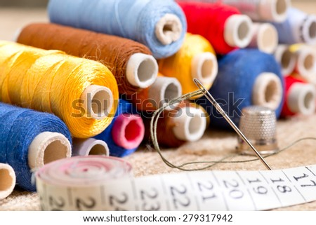 sewing kit with tape measure in the workroom - stock photo