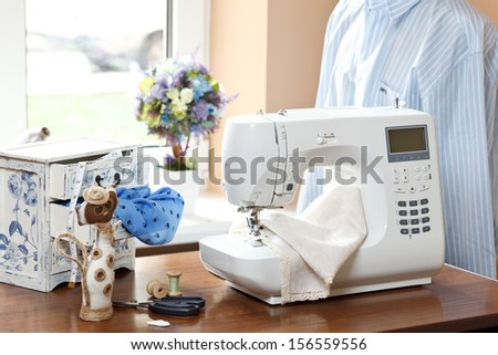 Sewing machine, dummy and other sewing equipment - stock photo