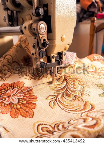 sewing machine in factory - stock photo