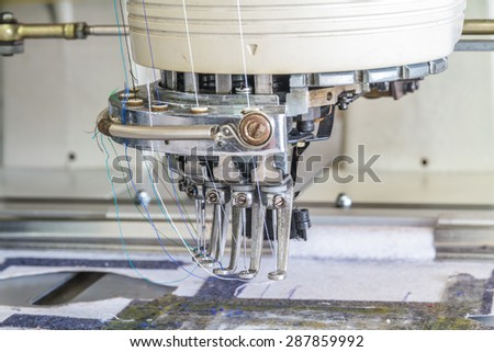 Sewing machine in Sewing Factory, Chiang Mai, Thailand. - stock photo