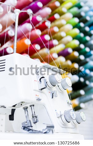 Sewing machine in tailor shop. - stock photo