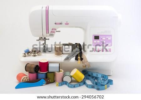 sewing machine isolated on white background - stock photo