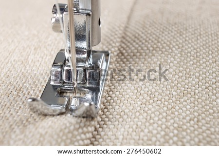 sewing machine makes a seam on fabric. sewing process - stock photo