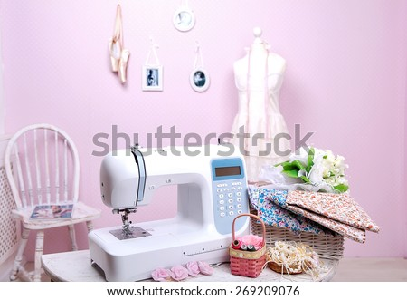 Sewing machine, mannequin nit.Shite and cut. The composition is unique for the fashion magazines. Layout of the sewing machine1. - stock photo