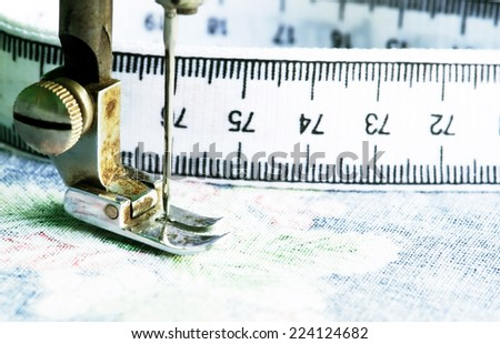 Sewing machine needle. - stock photo
