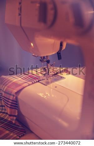 Sewing machine needle and fabric - stock photo