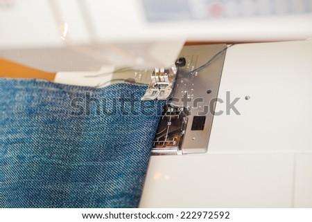 sewing machine scribbling denim. - stock photo