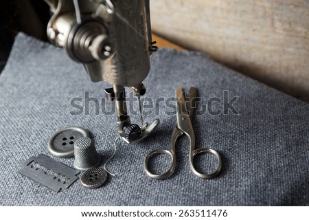 sewing machine with sewing tools  - stock photo