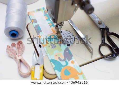 Sewing machine with sewing tools and accessories - stock photo