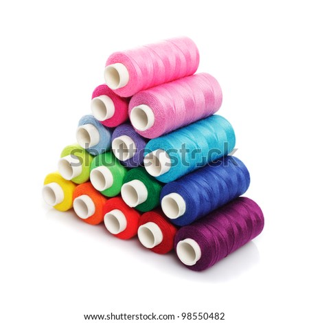 Sewing multicolored  threads isolated on white - stock photo