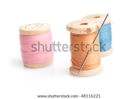 Sewing needle and threads. Isolated on white. - stock photo