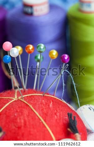 Sewing needles on the cushion - macro - stock photo