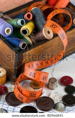 sewing supplies on the background patterns - stock photo