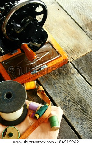 Sewing. The sewing machine and accessories (threads, needle, scissors).