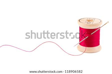 Sewing thread and needle on white - stock photo