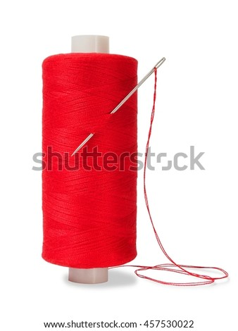 Sewing thread and needle on white background - stock photo