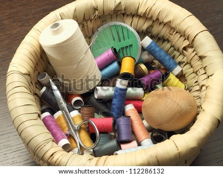 Sewing thread and sewing accessories - stock photo