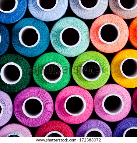 Sewing threads as a multicolored background close up - stock photo