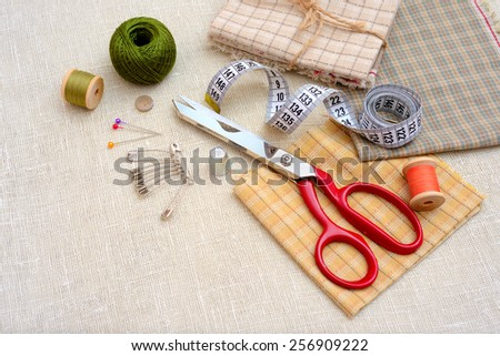 Sewing tools and accessories on table - stock photo