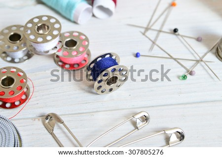 sewing tools and colored tape/Sewing kit. Scissors, bobbins with thread and needles - stock photo